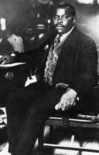 Marcus Garvey Sitting At Desk